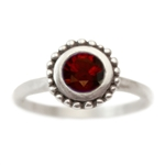 Cosmos Engagement ring with Garnet