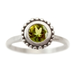 Cosmos Engagement ring with Peridot