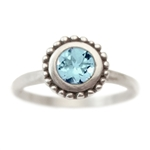 Cosmos Engagement ring with Blue Topaz